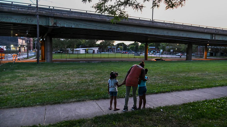 Octavia Scudder, center, watches Aaliyah, left, and A'mora as they walk near I-81.