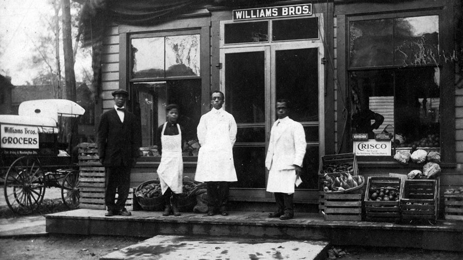 The Williams brothers stand outside their grocery store in Syracuse's 15th Ward in 1920. The neighborhood was once home to many businesses owned by African Americans.