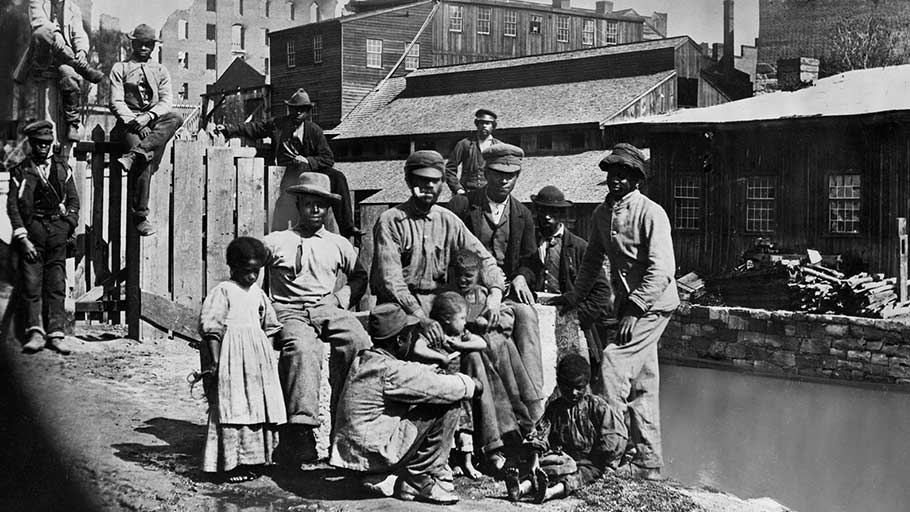 Former enslaved people in a Southern town shortly after the end of the Civil War, circa 1865.