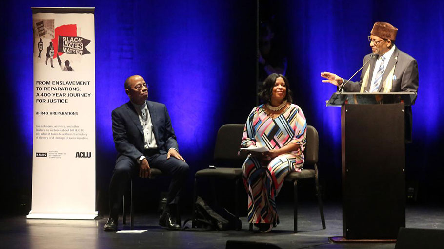 Jeffery Robinson with the ACLU (from left) and Trudy Grant with the National Action Network listen as Dr. Ron Daniels with the National African American Reparations Commission speaks during a national forum on reparations for slavery