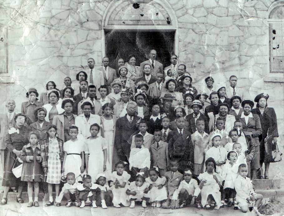 Antioch East Baptist Church members stand on the steps of their hand built sanctuary, the Old Stone Church, in Candler Park in 1948.
