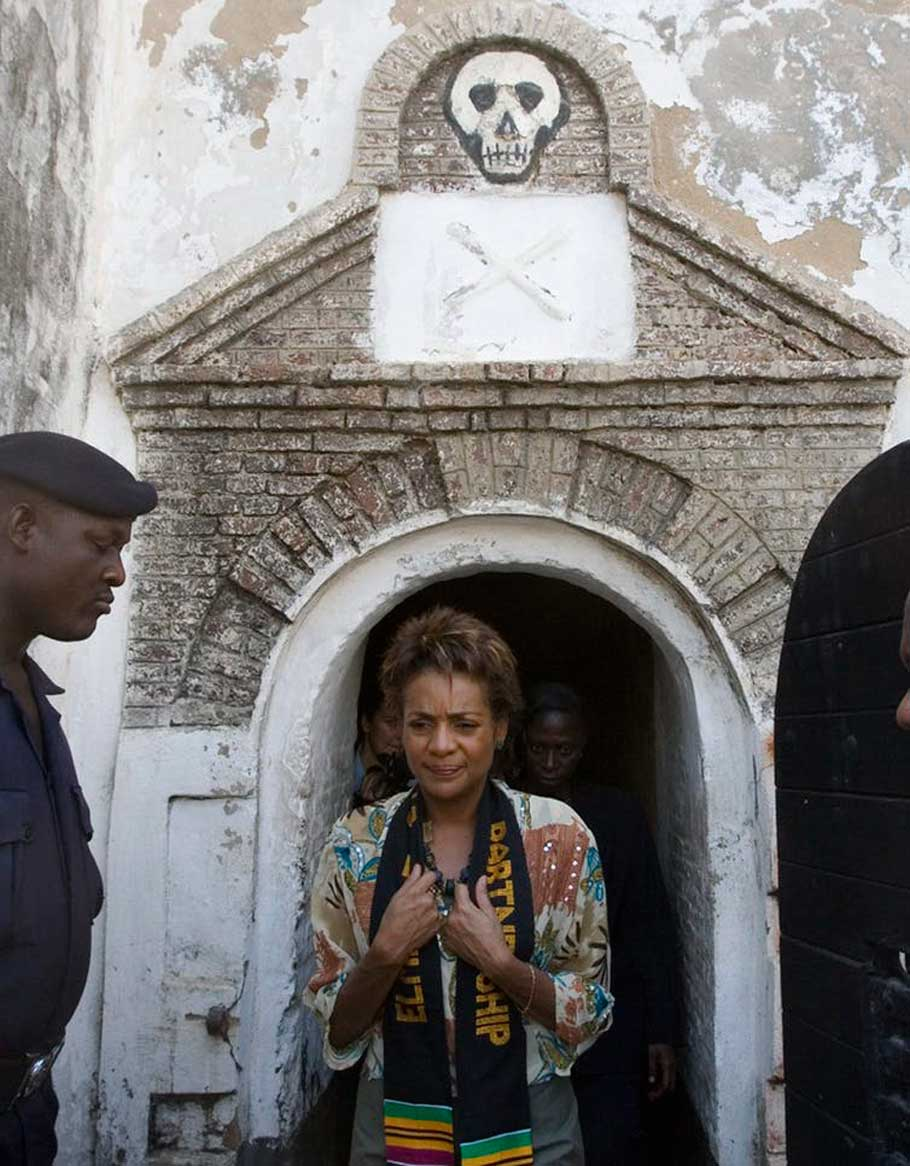 Michaëlle Jean leaves a room at Elmina Castle in Ghana