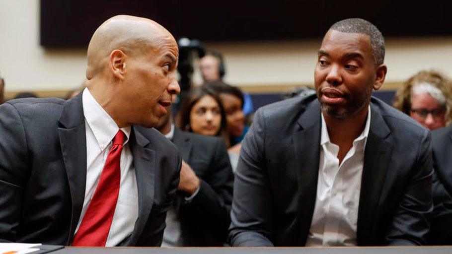Sen. Cory Booker, D-N.J., left, talks with author Ta-Nehisi Coates,
