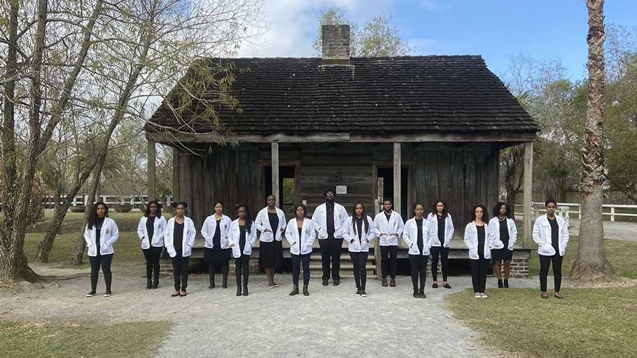 Sydney Labat, 24, and 14 of her Tulane University classmates posed at the Whitney Plantation in Wallace, La.