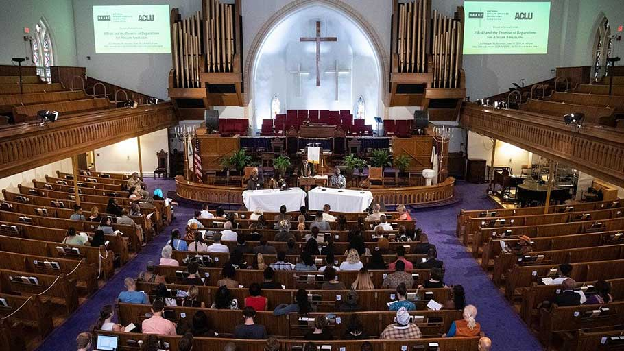"People attend the The National African American Reparations Commission and the American Civil Liberties Union's forum to discuss ""reparations as the country continues to reel from the impact of slavery and its legacy,"" at the Metropolitan AME Church in Washington, DC, on June 19, 2019."