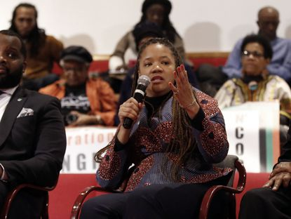 Ald. Robin Rue Simmons participates in a panel discussion during a meeting on reparations