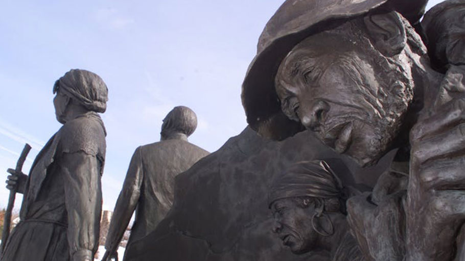 Slaves led to freedom by Harriet Tubman and others, as depicted in an Underground Railroad sculpture in Battle Creek,