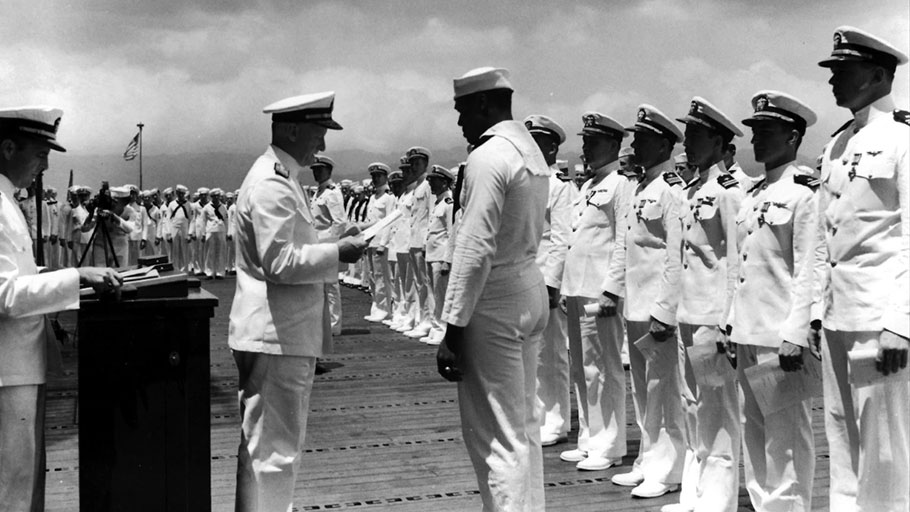 Doris Miller receives the Navy Cross from Adm. Chester W. Nimitz at Pearl Harbor on May 27, 1942.