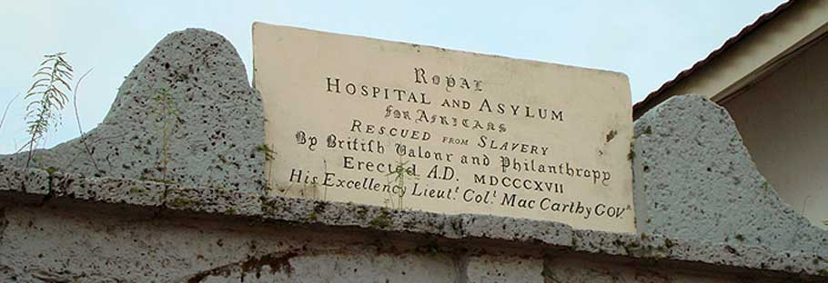 he sign above the Asylum, Kings Gate, Freetown, Sierra Leone.