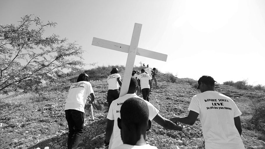 Mourners carry a cross in Port-au-Prince, in January, 2019, to honor the victims of the 7.0-magnitude earthquake that devastated Haiti