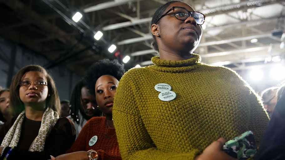 Attendees wear buttons supporting Sen. Elizabeth Warren at a campaign event at Clark Atlanta University on November 21, 2019, in Atlanta, Georgia.