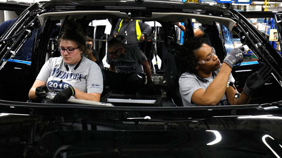Assembly line workers put final touches on 2018 Ford Expedition SUV at the Ford Kentucky Truck Plant in Louisville, Ky