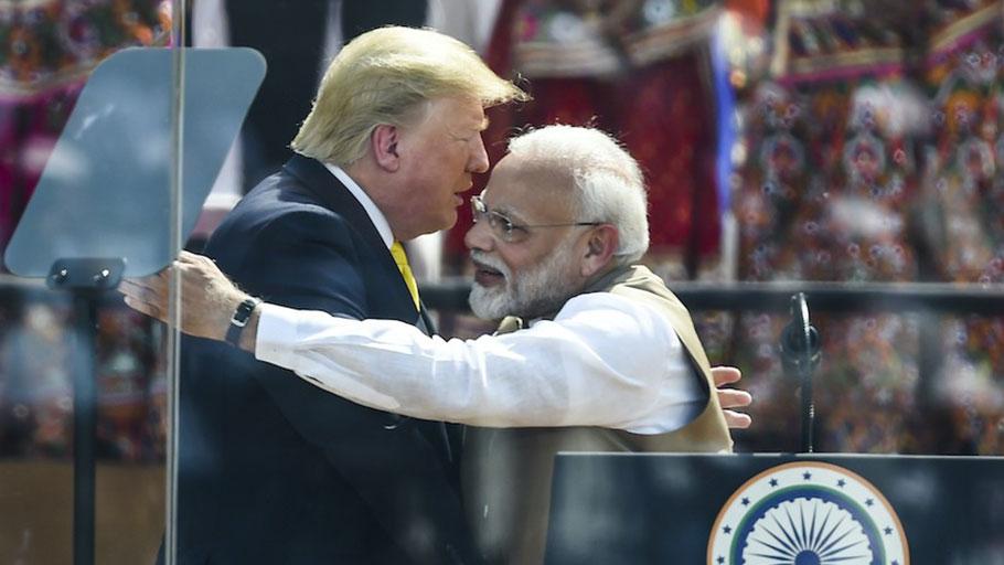U.S. President Donald Trump shakes hands with India's Prime Minister Narendra Modi