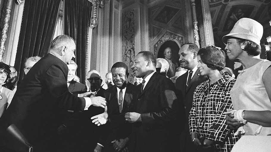 President Lyndon B. Johnson meets with Martin Luther King, Jr. at the signing of the Voting Rights Act of 1965. August 6, 1965.