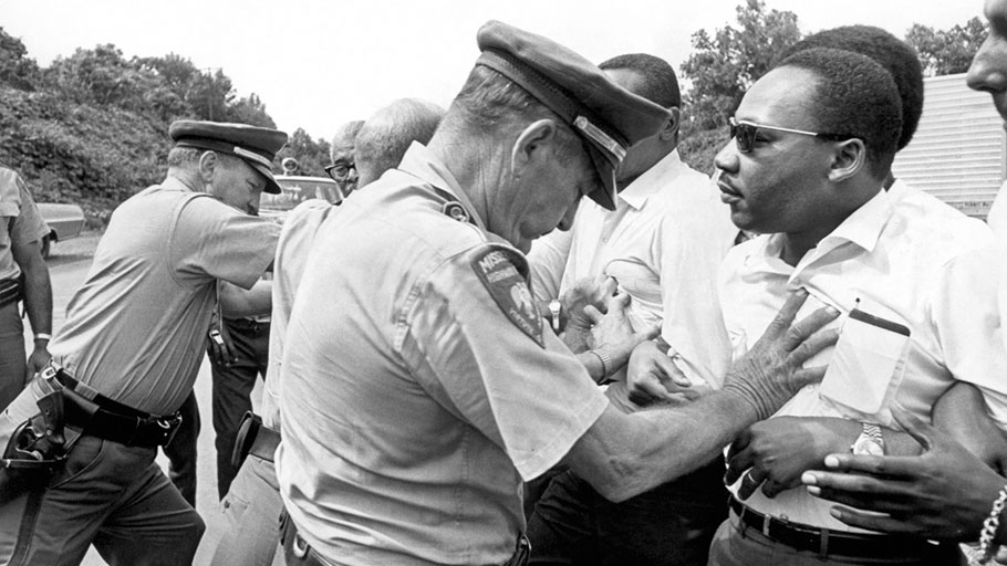 Dr. Martin Luther King, Jr. being shoved back by Mississippi patrolmen during the 220 mile 'March Against Fear' from Memphis, Tennessee to Jackson, Mississippi, on June 8, 1966.