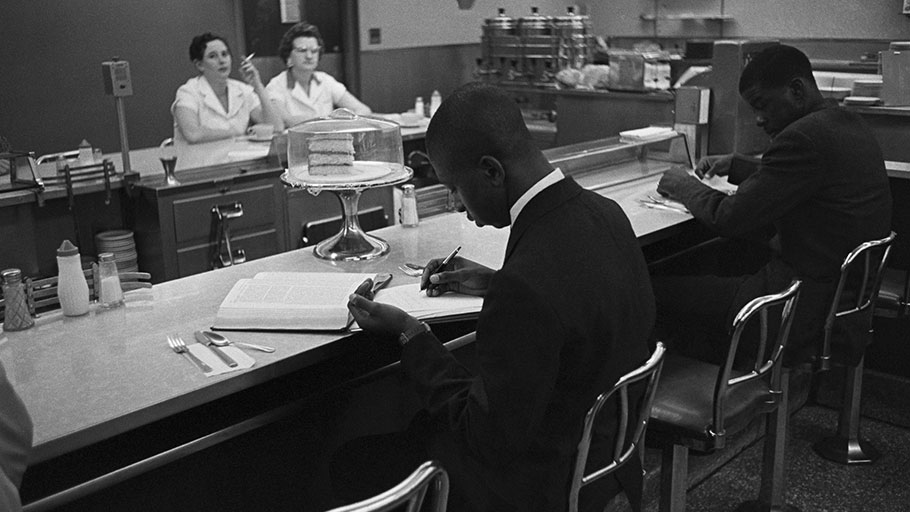 African-American students from Saint Augustine College study while participating in a sit-in at a lunch counter reserved for white customers in Raleigh, N.C.