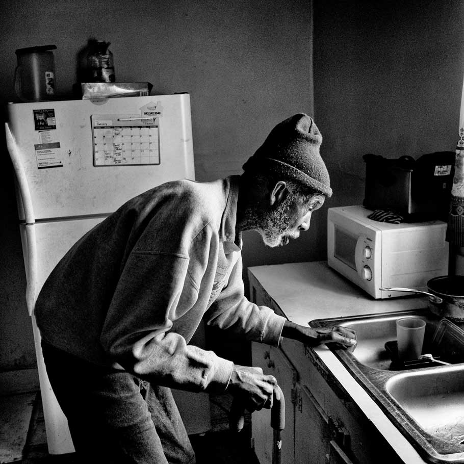 Denmark, S.C. | Saint Joseph Johnson, who died in January, in his kitchen last year; many in the town don't use tap water, saying the chemical HaloSan, which was added to protect pipes, has led to health issues.
