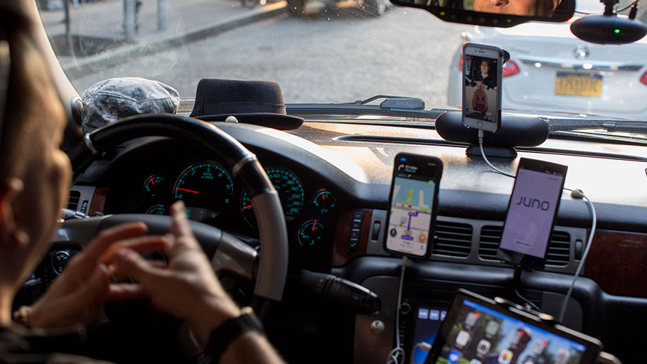 A driver for multiple ride-share companies with several devices on at once in New York, June 7, 2018.