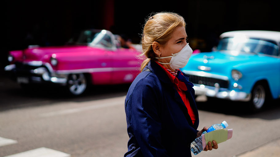 A woman wears a mask as a precaution against the spread of the new coronavirus at the Jose Marti International Airport in Havana, Cuba,