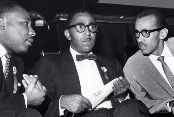 The Rev. Martin Luther King Jr., left, meets with the Rev. Joseph E. Lowery, center, and the Rev. Wyatt Tee Walker at First African Baptist Church in Richmond, Va., for the Southern Christian Leadership Conference convention on Sept. 25, 1963.
