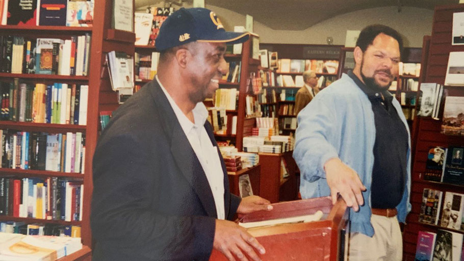 "James G. Spady, (in baseball hat) speaks to students at Stanford University bookstore in May 2000. Spady and H. Samy Alim (not shown) had published their first book together, ""Street Conscious Rap,"" in 1999."