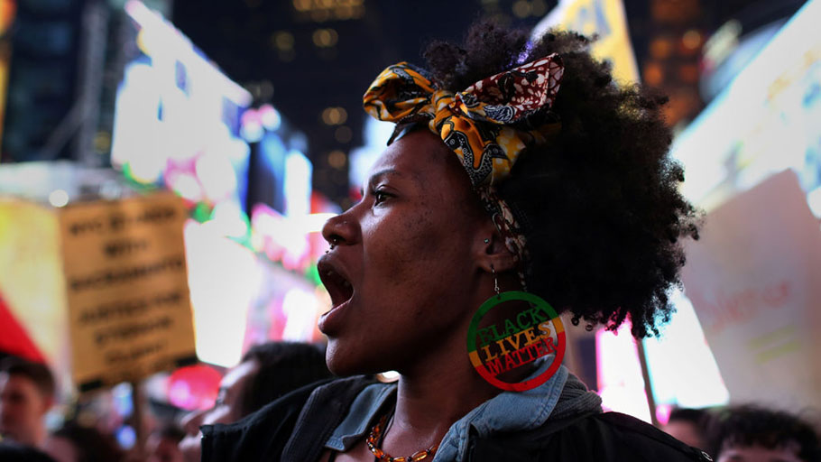 "A protester wearing a ""Black Lives Matter"" earring chants slogans as she marches in Times Square in the Manhattan borough of New York City, during a protest against the death of Stephon Clark in Sacramento, California, U.S. March 28, 2018."
