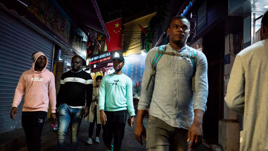 "Africans walk in the ""Little Africa"" district of Guangzhou, China on Mar. 1, 2018."
