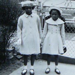 Gale Horton Gay and her sister in coats their mother made Easter Sunday, c. 1959