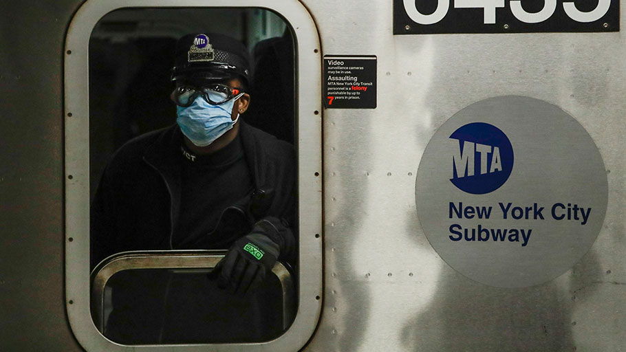 A New York MTA worker wears personal protective equipment at the Grand Army Plaza subway station in Brooklyn.