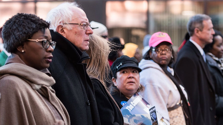 Democratic presidential candidate Sen. Bernie Sanders (I-VT) (2nd L) marches in the King Day at the Dome parade January 18, 2016 in Columbia, South Carolina.