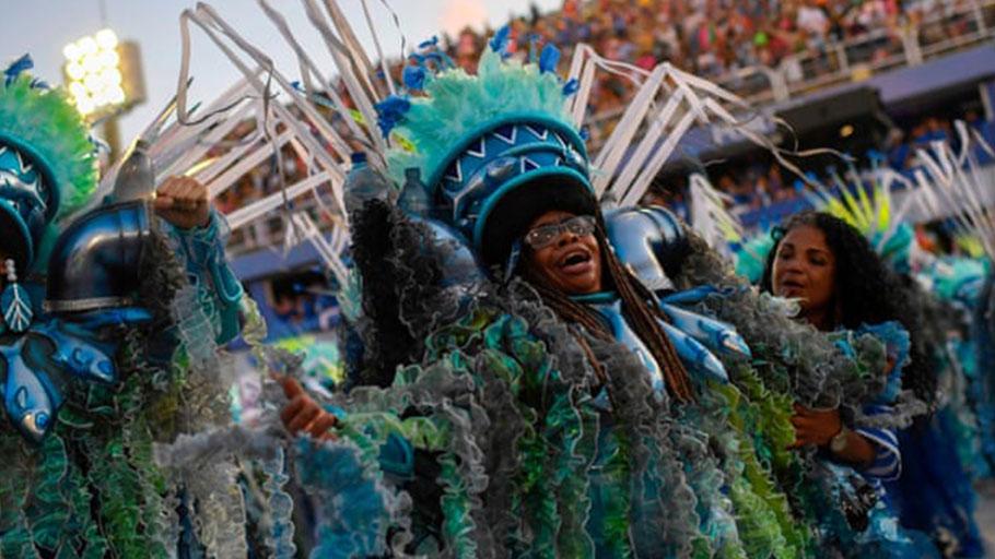 A member of the Portela samba school performs during the first night of Rio's carnival parade at the Sambadrome Marquês de Sapucaí.