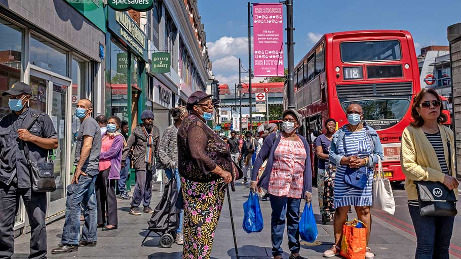 Shoppers on Brixton High Street in South London. As in the United States, ethnic minorities are disproportionately falling victim to the pandemic.