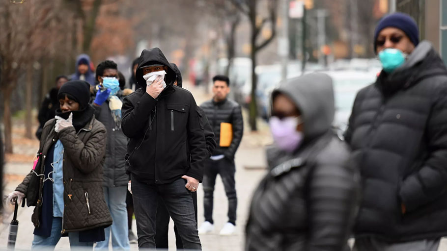 People who believe they have COVID-19, and who meet the criteria, wait in line to be pre-screened for the coronavirus outside of the Brooklyn Hospital Center on March 20 in Brooklyn, New York