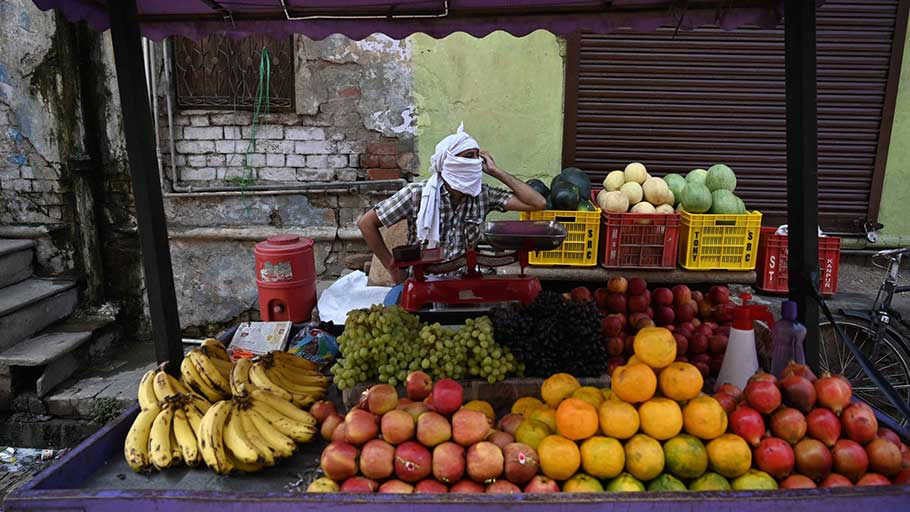 A fruit vendor waiting for customers during lockdown in Prayagraj, India. About 2 billion people worldwide work in the informal economy