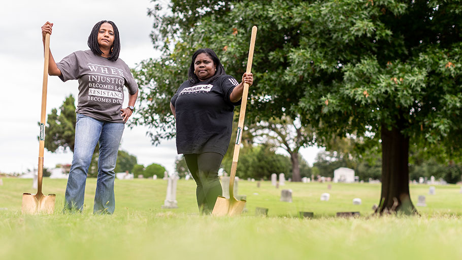Tulsa City Councilor Vanessa Hall-Harper and local activist Kristi Williams at Oaklawn Cemetery, where the city will dig for a possible mass grave from the 1921 Race Massacre.