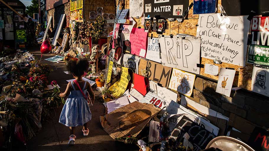 Somia Stewart, 3, walks through a memorial for Floyd at the intersection of 38th Street and Chicago Avenue in Minneapolis earlier this month.