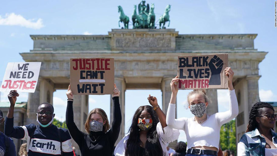 People attend a rally against racism in front of the Brandenburg Gate in Berlin on Sunday, May 31.