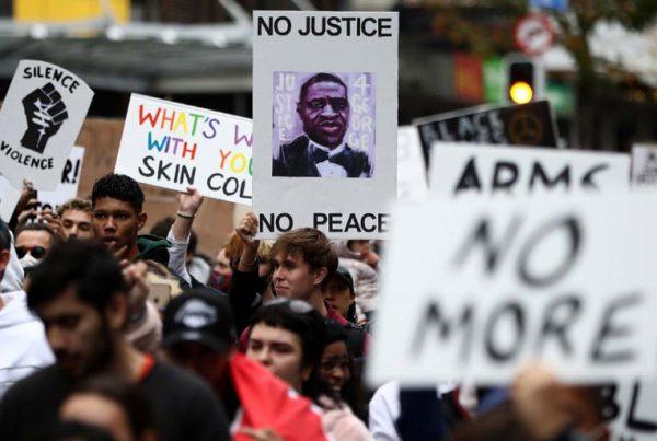 Protestors march down Queen Street in Auckland, New Zealand on Monday, June 1.