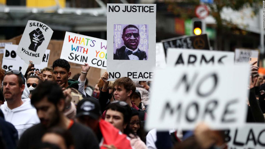 Protestors march down Queen Street in Auckland, New Zealand on Monday, June 1.