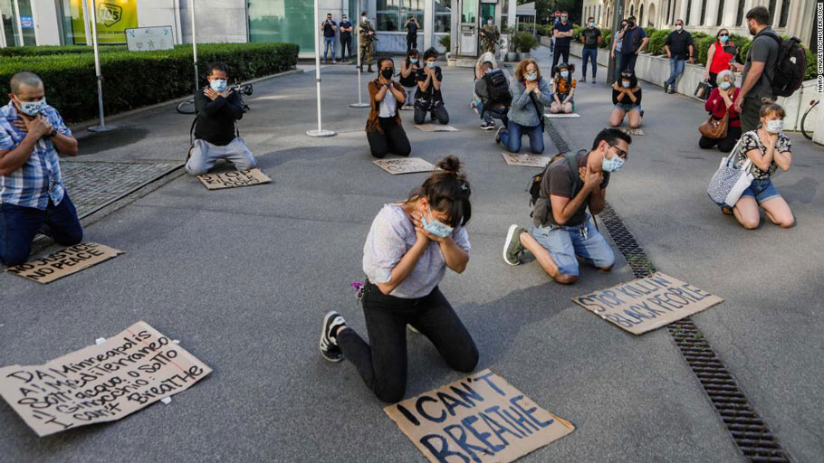 A flash mob gathers outside the American consulate in Milan, Italy on Thursday, May 28.