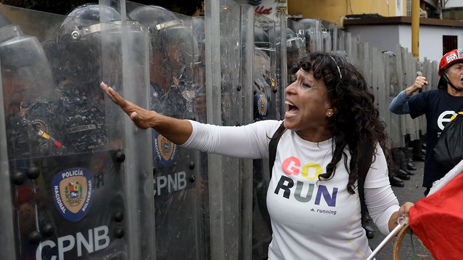 An anti-government demonstrator shouts at police officers during a protest on March 10, 2020 in Caracas. E
