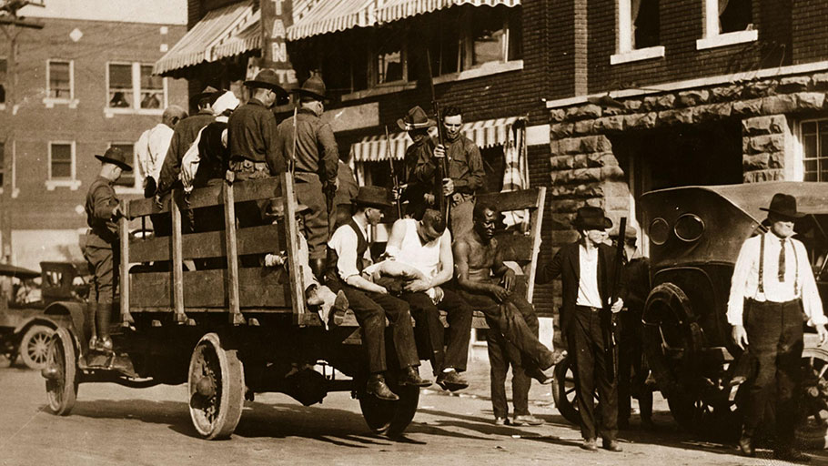 Injured and wounded prisoners are taken to hospital under guard after the Tulsa, Oklahoma race riots in 1921 when up to 300 African-Americans were massacred by white mobs