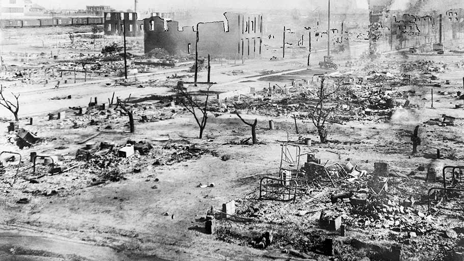 During the Tulsa race riots in 1921, black businesses and homes in the Greenwood District in Tulsa, Oklahoma, were destroyed at the hands of white residents.