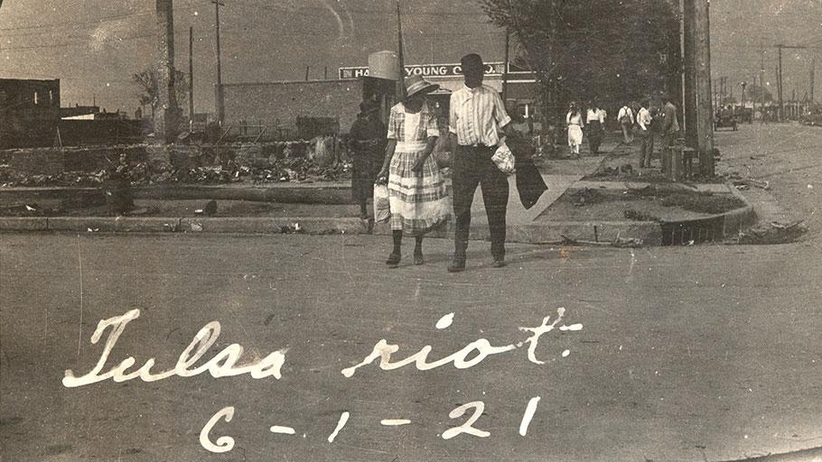 An African American couple walking across a street in Tulsa, Oklahoma, June 1921.