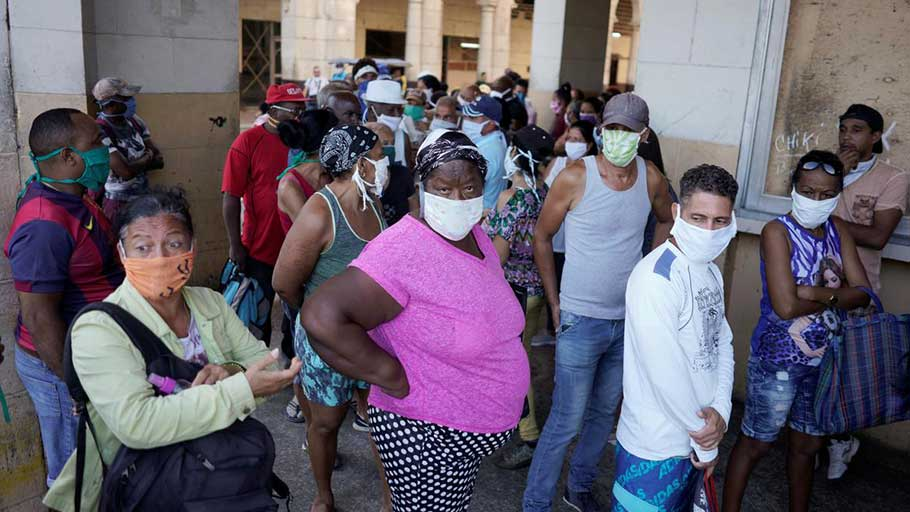 People line up to buy food amid concerns about the spread of the coronavirus disease (COVID-19), in downtown Havana, Cuba, April 3, 2020. Picture taken April 3, 2020.