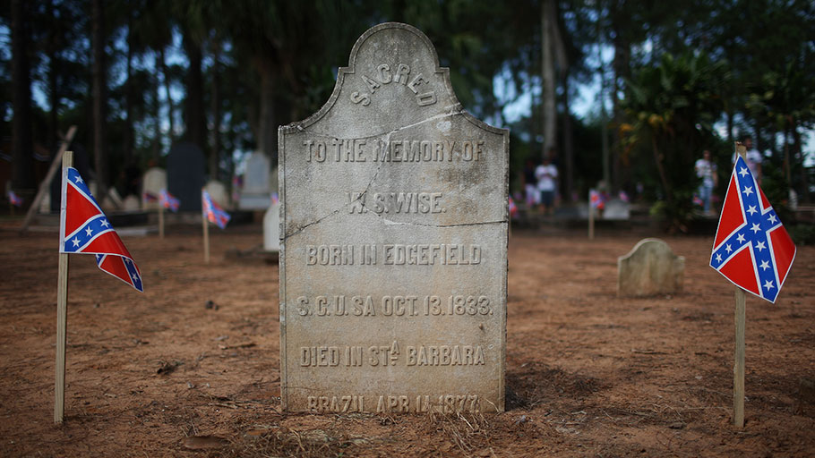 Confederate flags adorn the grave of a U.S. settler in the American Cemetery in Santa Bárbara d'Oeste during the 2016 Confederate Festival.