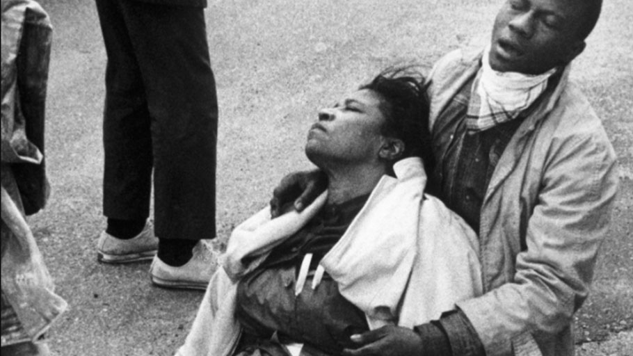 A civil rights marcher suffering from exposure to tear gas holds an unconscious Amelia Boynton Robinson after mounted police officers attacked marchers in Selma, Ala., as they were beginning a 50-mile march to Montgomery to protest race discrimination in voter registration.