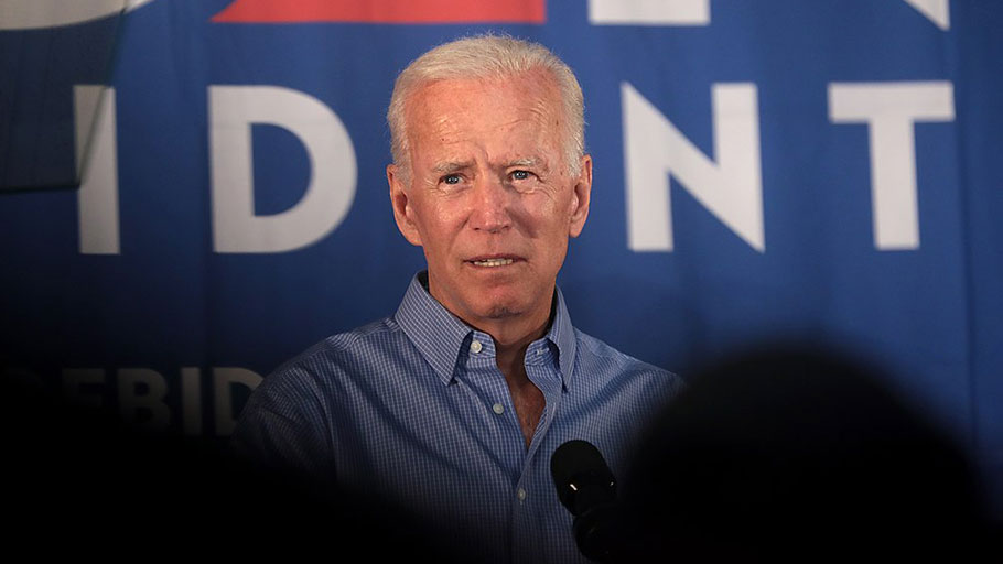 Former vice president Joe Biden speaking with supporters at a community event in Iowa, 2019.