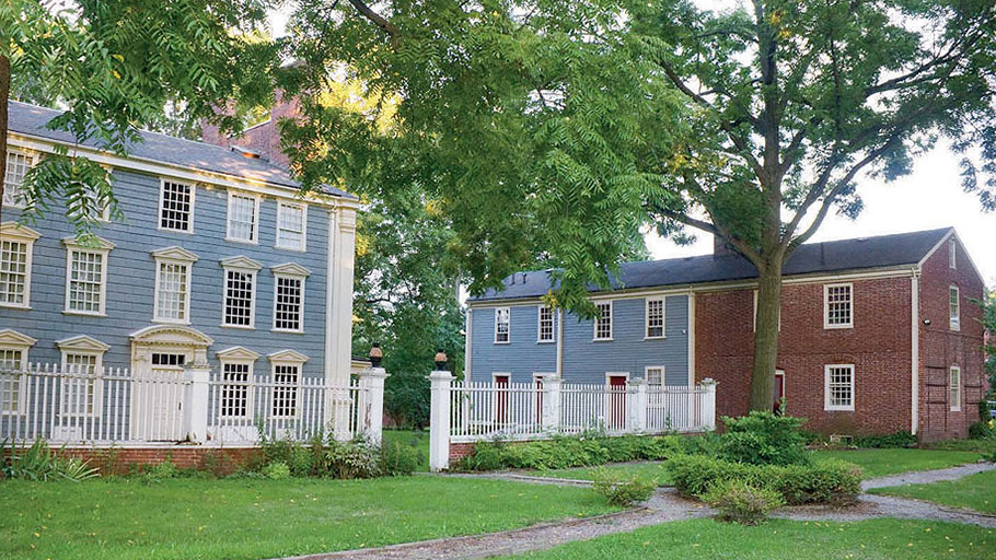 The Georgian mansion and adjacent slave quarters were once part of a 500-acre farm just north of Boston.
