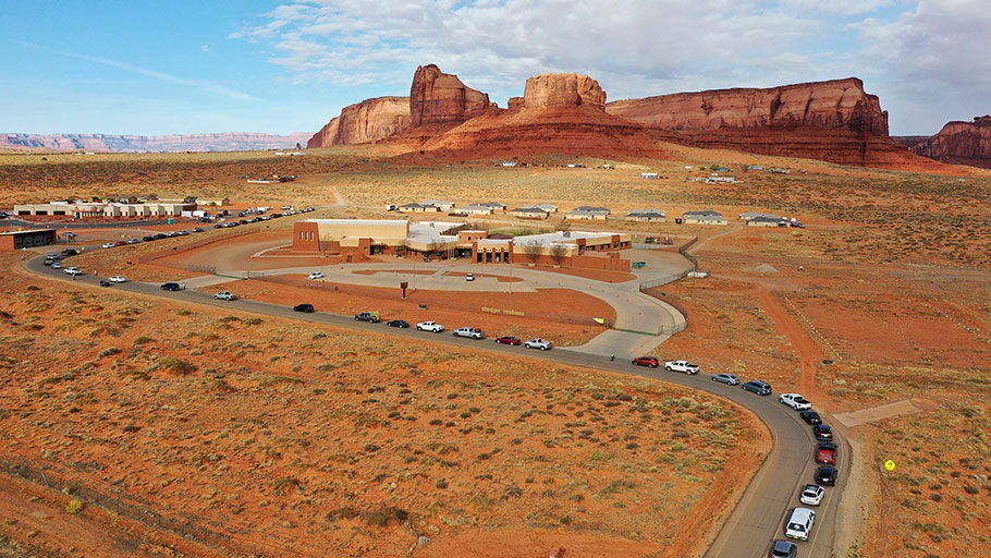 Vehicles line up for testing outside of the Monument Valley Health Center in Oljato-Monument Valley, Utah, on Apr. 17, 2020.